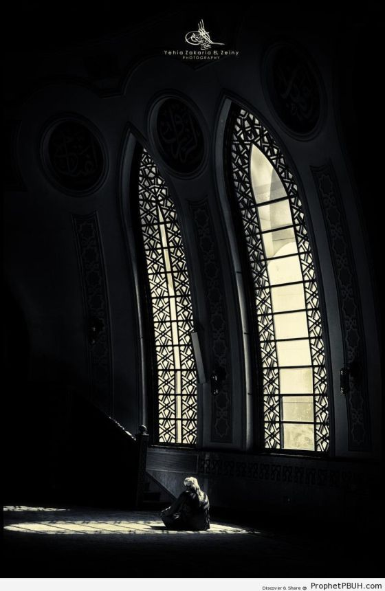 Light-Falling-on-Man-Sitting-in-Dark-Mosque-Prayer-Hall-Islamic-Architecture-Picture